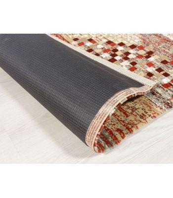 Base o Malla Antideslizante adhesiva a la base de la alfombra.